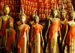 Buddha statues in Wat Xieng Thong in Luang Prabang , Laos shutterstock_92219815